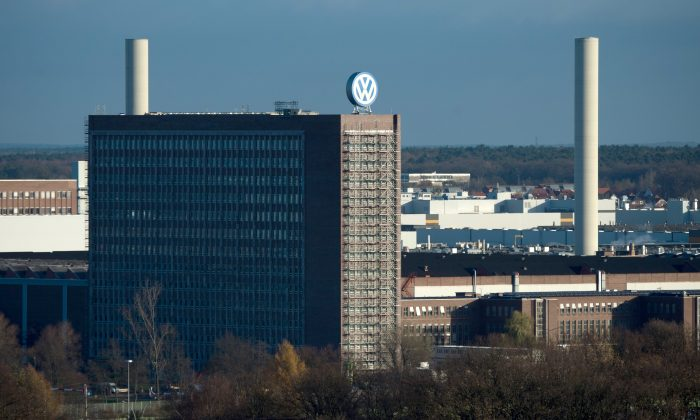 View of the Volkswagen factory in Wolfsburg, Germany, on Nov. 20, 2015. Volkswagen CEO Michael Mueller says the company's board has decided to reduce capital expenditures by $1.07 billion in 2016 as it deals with the fallout of its emissions-rigging scandal. Mueller said Friday after a meeting of the board at company headquarters in Wolfsburg, German, that the cuts would bring capital expenditure down to 12.8 billion next year. (Julian Stratenschulte/DPA via AP)