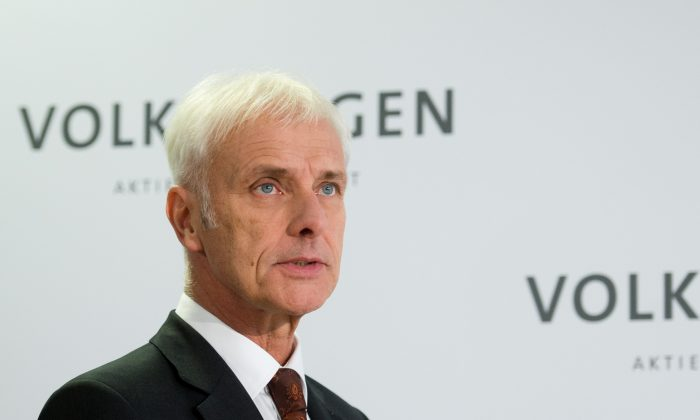 Matthias Mueller, Volkswagen AG CEO, speaks during a news conference in Wolfsburg, Germany, Friday, on Nov. 20, 2015. Mueller says the company's board has decided to reduce capital expenditures by $1.07 billion in 2016 as it deals with the fallout of its emissions-rigging scandal. Mueller said Friday after a meeting of the board at company headquarters in Wolfsburg, German, that the cuts would bring capital expenditure down to $12.8 billion next year. (Julian Stratenschulte/DPA via AP)
