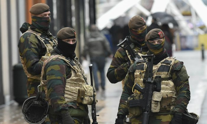 Soldiers patrol the Rue Neuve pedestrian shopping street in Brussels on Nov. 21, 2015. (John Thys/AFP/Getty Images)