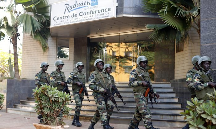 Soldiers from the presidential guard patrol outside the Radisson Blu hotel in Bamako, Mali, on Nov. 21, 2015. (Jerome Delay/AP Photo)