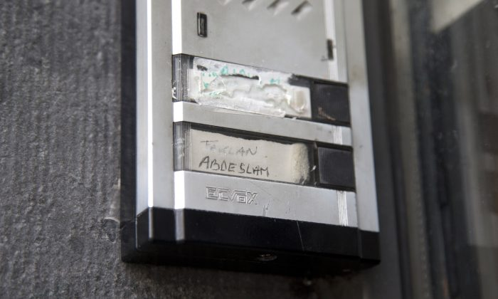The Abdeslam name is shown on the doorbell on the house of the family of Belgian militants Brahim and Salah Abdeslam in Molenbeek, Belgium, on Nov. 18, 2015. The family homes of the suspected mastermind of the Paris attacks and one of the suicide bombers stand only a few blocks apart in the Belgian capital's Molenbeek neighborhood. (AP Photo/Virginia Mayo)