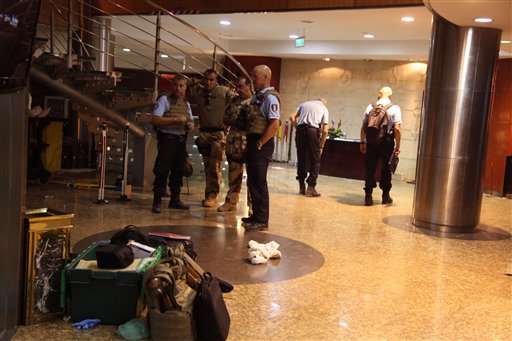 French troops, rear, inside the Radisson Blu hotel after an attack by gunmen on the hotel in Bamako, Mali, Friday, Nov. 20, 2015. Islamic extremists armed with guns and grenades stormed the luxury Radisson Blu hotel in Mali's capital Friday morning, and security forces worked to free guests floor by floor. (AP Photo/Baba Ahmed)