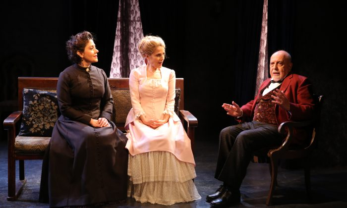 """(L–R) An old friend Christine Lind (Andrea Cirie) visits Nora (Jean Lichty) as does a family friend Dr. Rank (George Morfogen), in """"Nora."""" (Carol Rosegg)"""