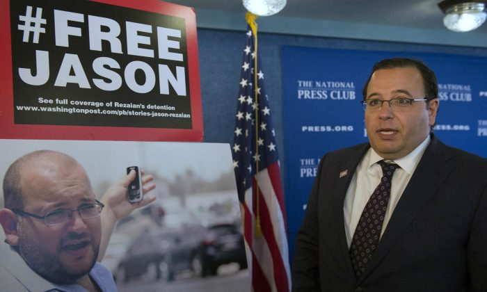Ali Rezaian, brother of Jason Rezaian—an Iranian-American correspondent for the Washington Post—talks about the photo of his brother at a news conference at the National Press Club during update on the case in Washington, on July 22, 2015. Iran has sentenced detained Jason Rezaian to an unspecified prison term following his conviction last month on charges that include espionage, Iranian state TV reported Sunday. (AP Photo/Molly Riley)