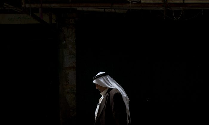 A Palestinian man walks in the Old City in Jerusalem, on Oct. 8, 2015. (AP Photo/Sebastian Scheiner)
