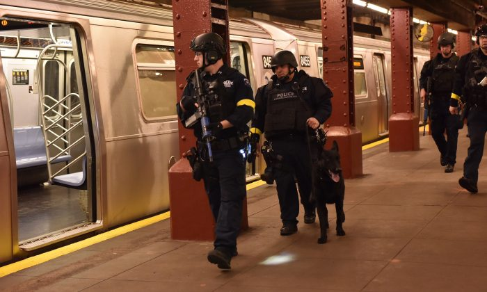 In an abandoned subway station in a Lower Manhattan, police stage a drill simulating a terrorist attack  Sunday Nov. 22, 2015, in New York.  Following the Nov. 13 terror attack in Paris and four days before New York's Macy's Thanksgiving Day Parade, emergency responders from the NYPD, Fire Deptartment of New York and Homeland Security participated in the drill. (New York Police Department via AP)