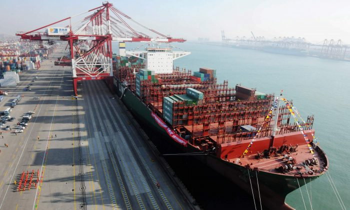 """The world's largest container ship, """"CSCL Globe,"""" docks at Port of Qingdao on Dec. 12, 2014 in Qingdao, Shandong Province, China. China Shipping Group Co., which owns CSCL, is in talks to merge with China Ocean Shipping Co. to potentially create the world's fourth-largest shipping company. (ChinaFotoPress/ChinaFotoPress via Getty Images)"""