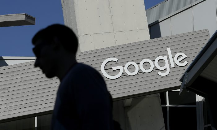A man walks past a building on the Google campus in Mountain View, Calif., on Nov. 12, 2015.  (AP Photo/Jeff Chiu)