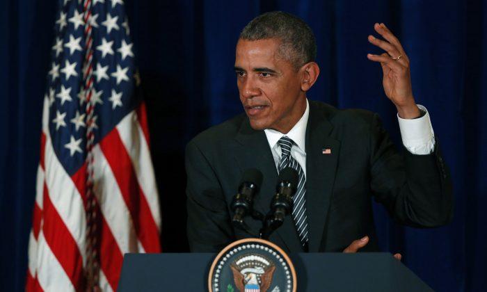 U.S. President Barack Obama speaks during a press conference in Kuala Lumpur, Malaysia, Sunday, Nov. 22, 2015.(AP Photo/Lai Seng Sin)