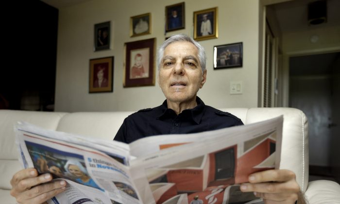"""In this Nov. 17, 2015, photo, Sal Natale looks over a Medicare brochure at his home in Seminole, Fla. Rising drug costs are starting to hit Medicare's popular prescription drug program, with many senior citizens looking at double digit premium increases next year. Natale, a retired dentist, said prescription premiums for him and his wife are going up about 30 percent next year, and he doesn''t see a good alternative. """"I'm just going to grin and bear and hope it starts moderating,"""" Natale said.  (AP Photo/Chris O'Meara)"""