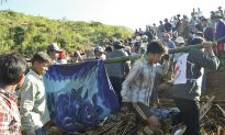 Landslide in Burma Kills About 100; Many Others Missing