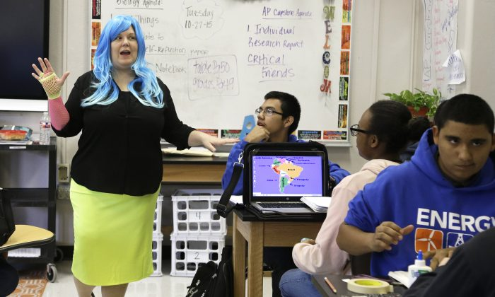 Biology teacher Amanda Alexander directs her students during class at Houston Energy Institute High School Tuesday, Oct. 27, 2015, in Houston. In Texas, education officials are gearing up to prepare more young people for the oil patch, showing the state's unshakeable commitment to the energy sector despite the employment uncertainties. (AP Photo/Pat Sullivan)