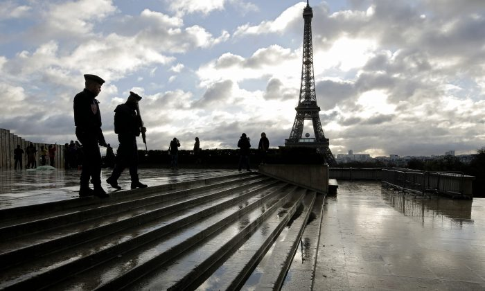 French soldiers patrol the Trocadero place near the Eiffel Tower, in Paris, on Nov. 21, 2015. (AP Photo/Laurent Cipriani)