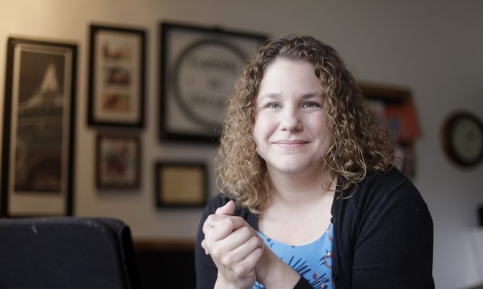 In this Friday, Nov. 20, 2015, photo, Andrea Quenette, an assistant professor of communication studies at the University of Kansas, poses for a photo at her home in Lawrence, Kan. Quenette is on paid leave after using a racial slur during a class discussion about race. (Mike Yoder/The Lawrence Journal-World via AP)