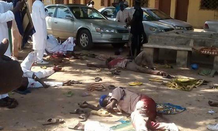 Bodies lies on the ground following a bomb explosion in Yola, Nigeria, Friday, Oct. 23, 2015. (AP Photo/Ibrahim Abdulaziz)