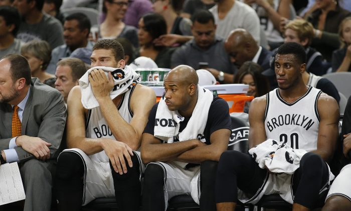 Brook Lopez (L), Jarrett Jack (C), and Thaddeus Young of the Brooklyn Nets have lost 11 of their first 14 games this season. (Chris Covatta/Getty Images)