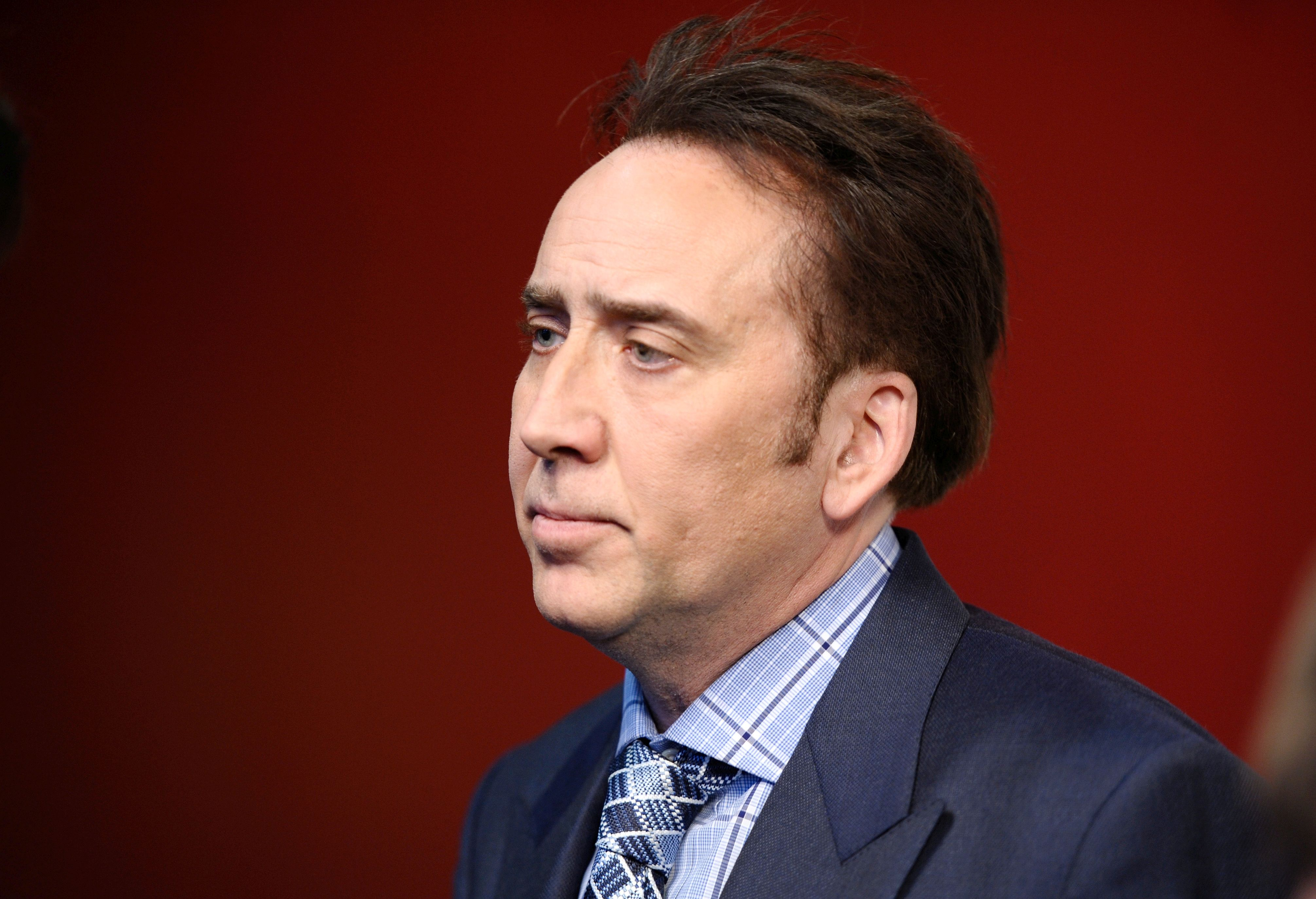 """Actor Nicolas Cage attends the """"Joe"""" screening hosted by Lionsgate and Roadside Attractions with The Cinema Society at Landmark Sunshine Cinema on April 9, 2014, in New York City. (Ilya S. Savenok/Getty Images)"""