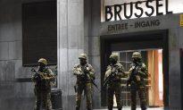 Belgium Police Arrest 21, Paris Fugitive Still at Large