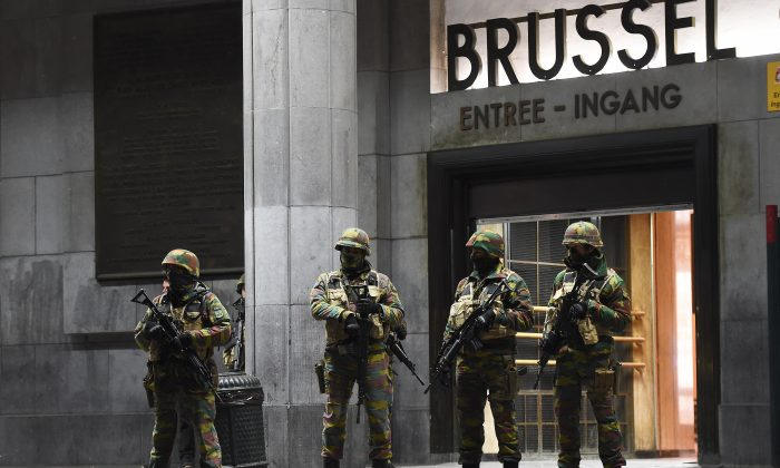 Soldiers stand guard in front of the central train station on Nov. 22, 2015, in Brussels, as the Belgian capital remained on the highest security alert level over fears of a Paris-style attack. (Emmanuel Dunand/AFP Photo)