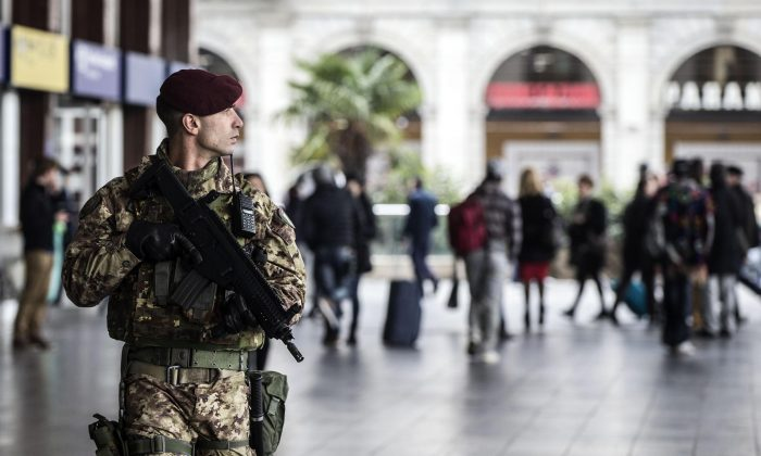 A soldier patrols outside Rome's Termini main train station, Monday, Nov. 23, 2015. Italy and the Vatican beefed up security with some 700 soldiers deployed following the Paris attacks and before Pope Francis' big Jubilee Year starting Dec. 8. (Angelo Carconi/ANSA via AP)