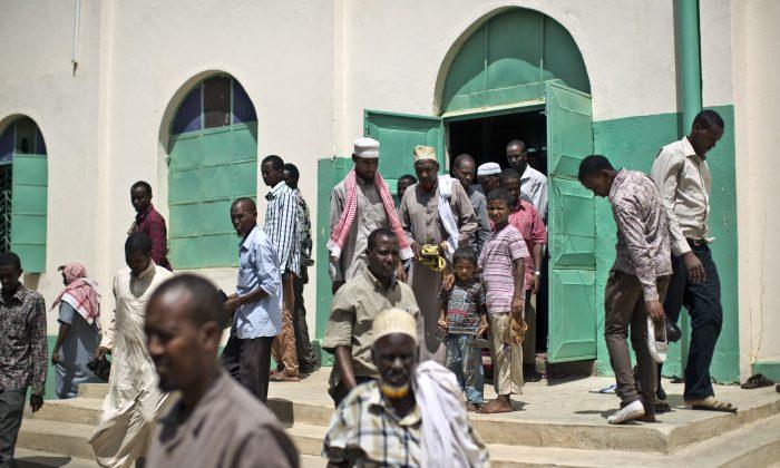 In this photo taken Monday, Nov. 9, 2015, Kenyan Muslim men leave after making afternoon prayers at the Ibnu-qeym Mosque in Garissa, Kenya. (AP Photo/Ben Curtis)