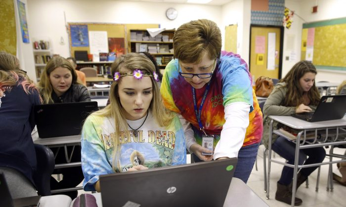A file photo shows a teacher instructing a student on a laptop as they prepare for a special project in Hagerstown, Md., on Nov. 12, 2015. (Patrick Semansky/AP Photo)