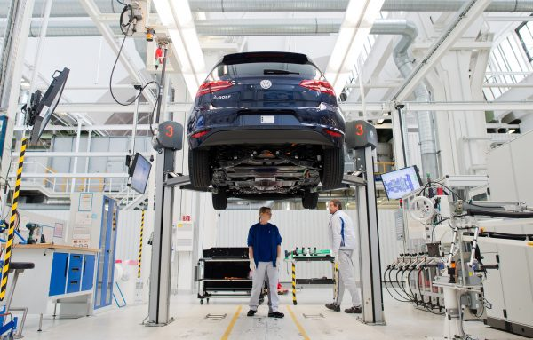 Employees of German carmaker Volkswagen (VW) work on an electric car e-Golf on an assembly line at VW plant in Wolfsburg, central Germany, on Oct. 21, 2015. (Julian Stratenschulte/AFP/Getty Images)