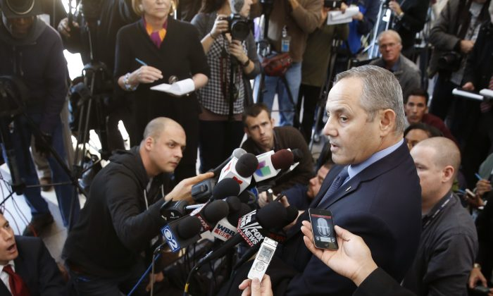 Dean Angelo, Fraternal Order of Police Lodge #7 president, right, talks to reporters after a bond hearing for Chicago police officer Jason Van Dyke, on murder charges in the killing of 17-year-old Laquan McDonald, Tuesday, Nov. 24, 2015, in Chicago. (AP Photo/Charles Rex Arbogast)
