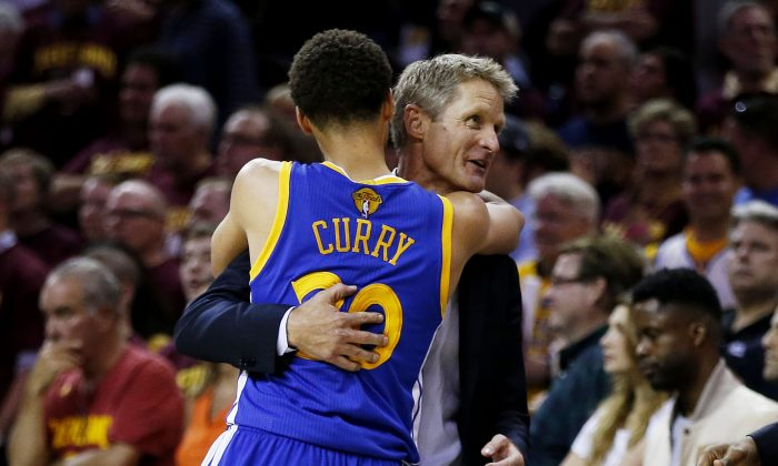 Stephen Curry (L) of the Golden State Warriors is a big reason why he and coach Steve Kerr won the NBA title last June. (Ezra Shaw/Getty Images)