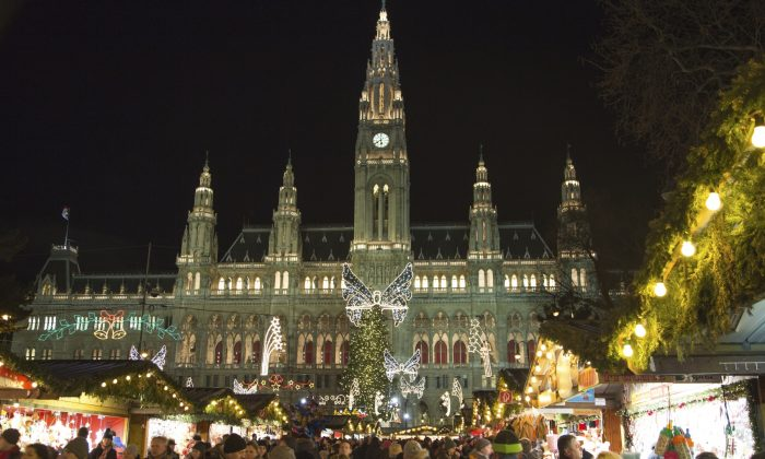 Shoppers check out the decorated stalls for sweets, baking, and handcrafted gifts at the Christmas market in front of Vienna's city hall. (tgasser/iStock)