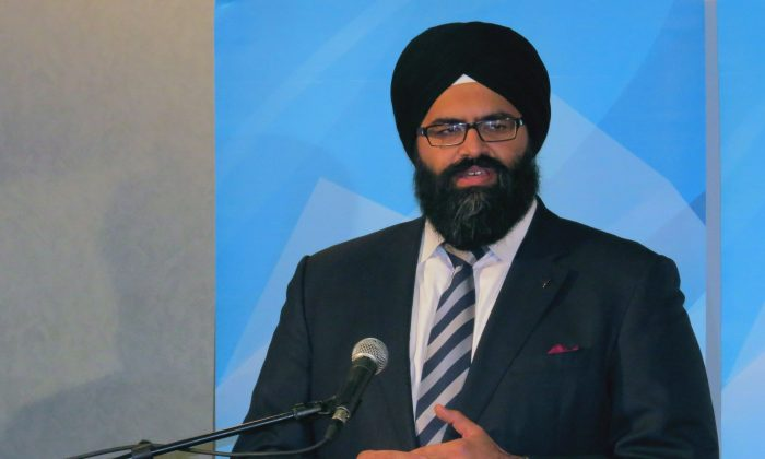 Alberta Human Services Minister Manmeet Bhullar announces new initiatives to improve the investigation and reporting of the deaths of children in government care during a press conference in Edmonton on Jan. 8, 2014. Bhullar was killed was killed on Nov. 24, 2015, while driving from Calgary to Edmonton during a winter storm. (THE CANADIAN PRESS/Dean Bennett)