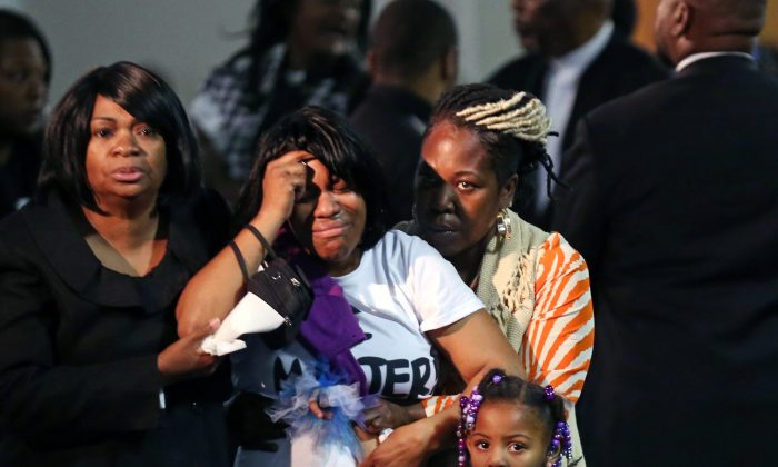Family members of Jamar Clark are overcome with emotion as they said their goodbyes during his funeral services at Shiloh Temple International Ministries Wednesday, Nov. 25, 2015 in Minneapolis. (Jerry Holt/Star Tribune via AP)