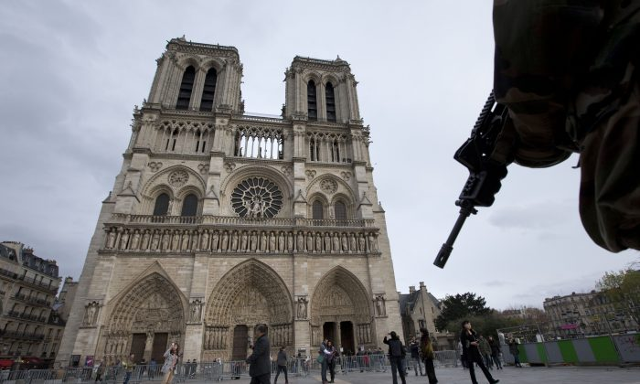 A soldier patrols the Notre Dame Cathedral in Paris on Nov. 16. (Peter Dejong/AP Photo)