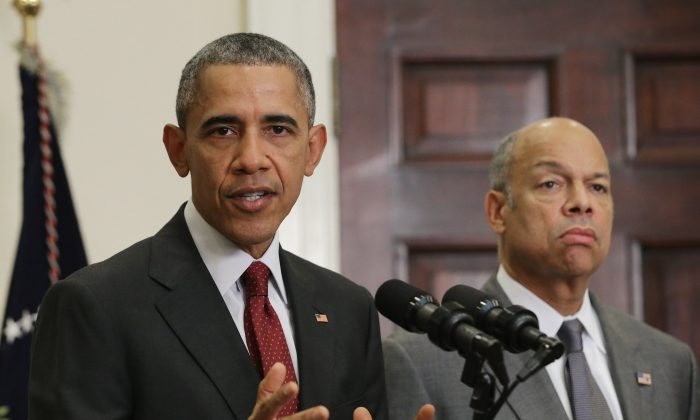 President Barack Obama, with Homeland Security Secretary Jeh Johnson (R), delivers a statement in the Roosevelt Room following a national security meeting in the Situation Room at the White House November 25, 2015 in Washington, DC. Obama said the American people should continue with their Thanksgiving holiday plans and 'We are taking every possible step to keep our homeland safe'. (Photo by Chip Somodevilla/Getty Images)