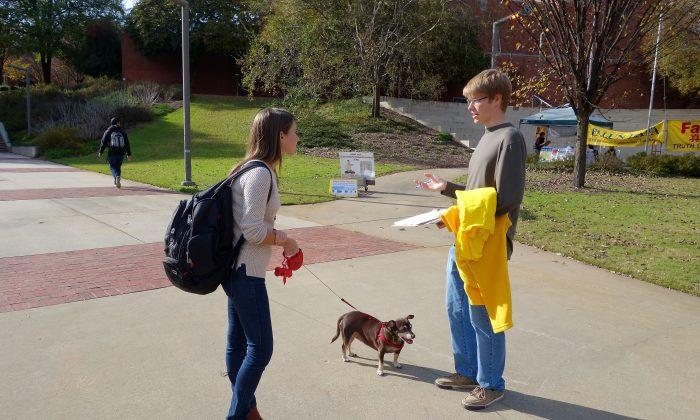 John Perry (R) talks to a fellow student at Georgia Tech University in Atlanta on Nov. 16, 2015. (Mary Silver/Epoch Times)