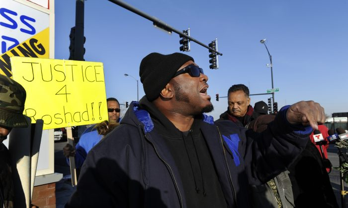 Fred Hampton Jr. argues with a television reporter during a vigil for 17-year-old Laquan McDonald, who was fatally shot and killed Oct. 20, 2014 in Chicago. (AP Photo/Paul Beaty)
