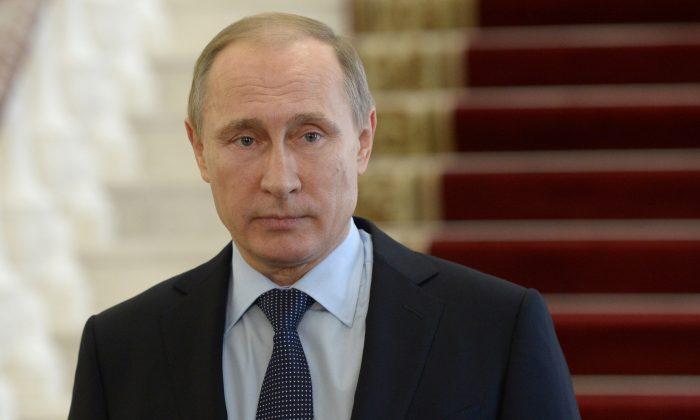 Russian President Vladimir Putin meets the press in Nizhny Tagil in the Ural mountains, Russia, on Wednesday, Nov. 25, 2015. (Alexei Nikolsky/Sputnik, Kremlin Pool Photo via AP)