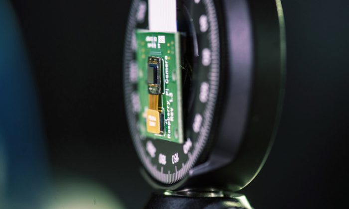 """""""Moving from a cube design to just a surface without sacrificing performance opens up so many possibilities,"""" says Richard Baraniuk. """"We can make curved cameras, or wallpaper that's actually a camera. You can have a camera on your credit card or a camera in an ultrathin tablet computer."""" (Credit: Jeff Fitlow/Rice)"""