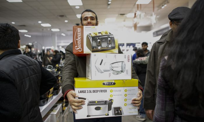 A man shop at the JCPenney store at the Newport Mall on November 27, 2014 in Jersey City, New Jersey. Black Friday sales, which now begin on the Thursday of Thanksgiving, continue to draw shoppers out for deals and sales. (Photo by Kena Betancur/Getty Images)