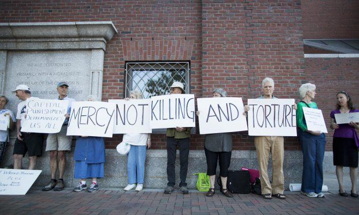 Death penalty protesters outside of John Joseph Moakley United States Courthouse in Boston during the official sentencing of Boston Marathon Bomber Dzhokar Tsarnaev on June 24, 2015. (Scott Eisen/Getty Images)