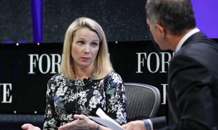 Marissa Mayer (L) and Adam Lashinsky speak on a panel during the Fortune Global Forum - Day2 at the Fairmont Hotel on November 3, 2015 in San Francisco, California.  (Kimberly White/Getty Images for Fortune)