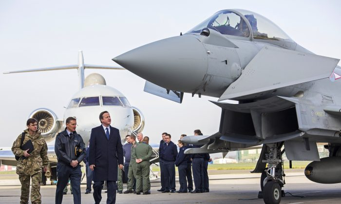 British Prime Minister David Cameron at RAF Northolt, London. He stopped to talk to service personal and view military hardware on his way back from visiting President Hollande in Paris and is ahead of the SDSR statement on Nov. 23, 2015. (Jack Hill)
