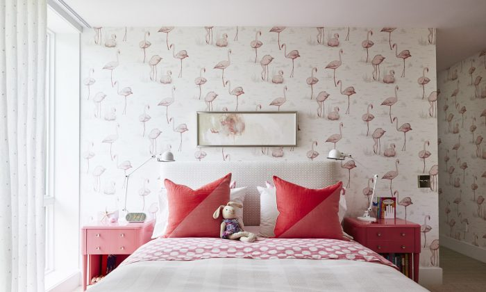 Playful flamingo wallpaper and punches-of-pink accessories decorate Richardson's daughter's bedroom. (At Home: Sarah Style)