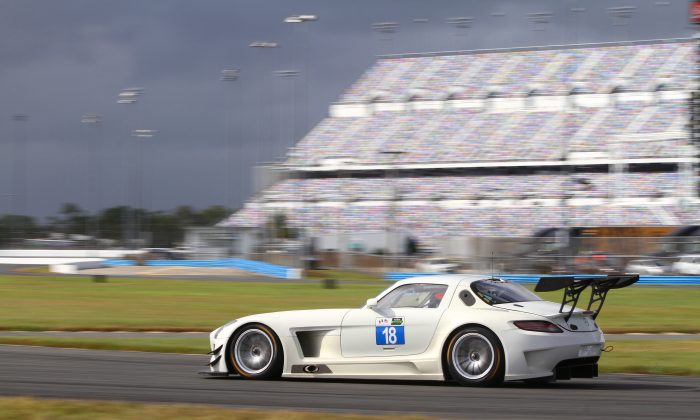 The #18 Mercedes-Benz SLS AMG GT3 streaks past the newly expanded grandstands at Daytona International Speedway on Day Two of the IMSA WSCC open test, Nov. 18, 2015. (Chris Jasurek/Epoch Times)