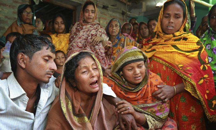 Relatives of people killed as unidentified gunmen attacked a mosque during evening prayers on Thursday, grieve before their funeral in Bangladesh's Bogra district, Friday, Nov. 27, 2015. (AP Photo)