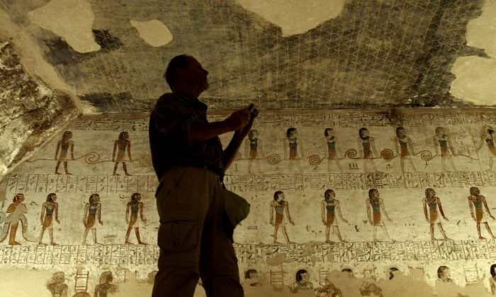 A tourist takes photos of inscriptions on the walls of King Merenptah's tomb in the Valley of the Kings in Luxor, Egypt, on Nov. 22, 2012. Egypt says there is a 90% chance that hidden chambers will be found within King Tutankhamun's tomb, based on the preliminary results of a new exploration of the 3,300-year-old mausoleum. Speaking at a press conference in Luxor on Saturday, Nov. 28, Mamdouh el-Damaty said the results will be sent to Japan for a month-long analysis before the search is resumed. (AP Photo/Nariman El-Mofty)