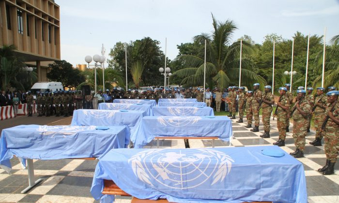The coffins of nine UN soldiers are draped with U.N. flags during a service at the headquarters of MINUSMA, the U.N. mission in Mali on Oct. 7, 2014, in Bamako. The soldiers, all from Niger, were on a supply run in the north-eastern desert on Oct. 3, when they were targeted by armed men on motorbikes. (Habibou Kouyate/AFP/Getty Images)