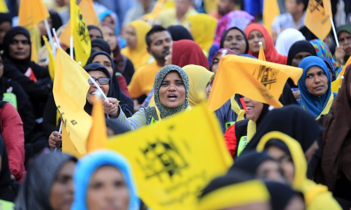 Supporters of former Maldivian president Mohamed Nasheed participate in a protest rally in Male, Maldives, Friday, Nov. 27, 2015. Hundreds of opposition supporters have started a three-day long protest demanding the release of the country's ex-president and other politicians and activists in jail. (AP Photo/Sinan Hussain)