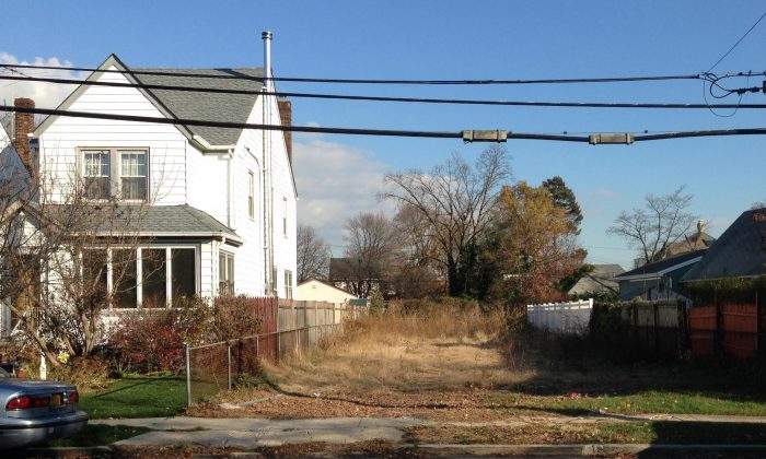 In this photo of Nov. 25, 2015, a lot stands empty in West Hempstead, N.Y., after the township had the home that once stood on it torn down. Homeowner Philip Williams says he went to Fort Lauderdale for the knee replacement in December, 2014. When he returned to the West Hempstead home in August 2015, his home was gone. (AP Photo/Frank Eltman)