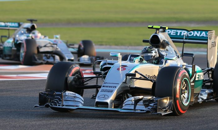 Mercedes driver Nico Rosberg of Germany steers his car in front of his team driver Lewis Hamilton of Britain during the Emirates Formula One Grand Prix at the Yas Marina racetrack in Abu Dhabi, United Arab Emirates, Sunday, Nov. 29, 2015. (AP Photo/Kamran Jebreili)
